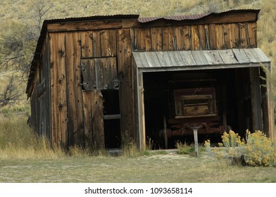 Ghost Town buildings: Scenes from Bannack State Park, Montana. Livery shed with old wagon.