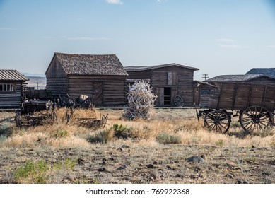 Ghost Town With Old cabins and Antique Wood Wagons
