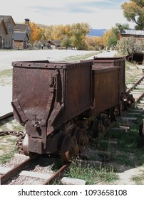 Ghost Town scene from Bannack State Park, Montana of old mining ore cars on tracks.