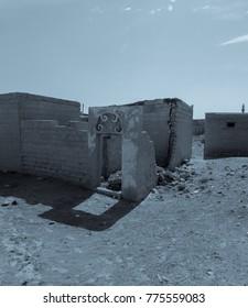 Ghost town under the moon. Arabian Peninsula. Al Jazirah Al Hamra. United Arab Emirates