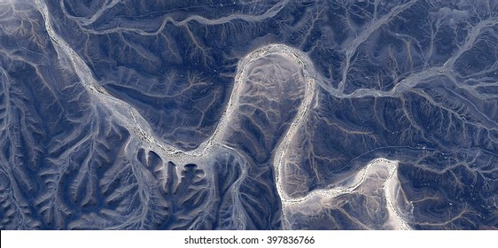 ghost, tribute to Dalí, abstract photography of the deserts of Africa from the air,aerial view, abstract expressionism, contemporary photographic art, abstract naturalism,