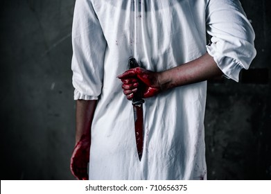 Ghost woman Hold the knife behind. horror of scary fear on hell is monster devil girl in halloween festival concept