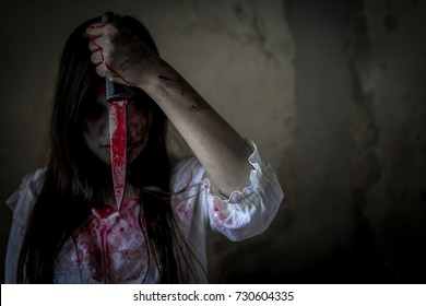 Ghost woman or zombie hold knife for kill with blood violence in house of ruin, nightmare, horror of scary fear on hell is monster devil in halloween festival, copy space the right.