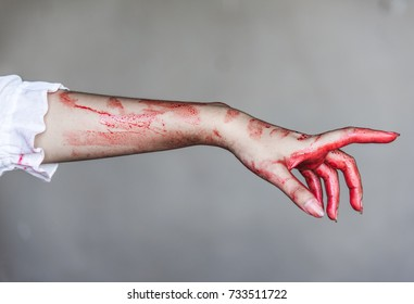 Ghost woman or Zombie stretching bloody hands, halloween concept