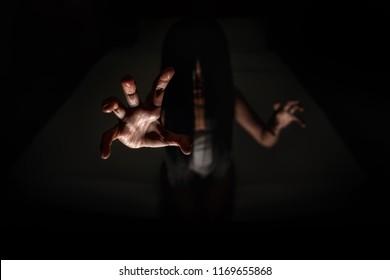 ghost women hand in haunted hotel with dark filter, halloween concept