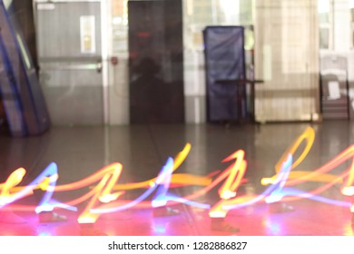 Ghostly feet fly across the floor with light trails