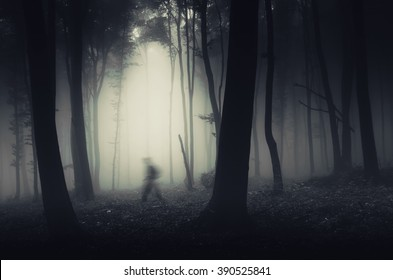 ghostly figure in dark spooky forest halloween scene