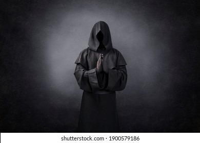 Ghostly figure praying in the dark