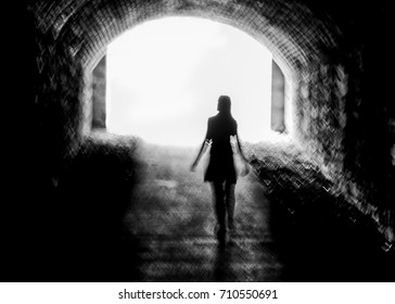 Ghostly figure walking through a tunnel