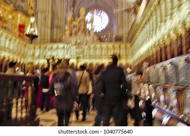 ghostly figures in the cathedral choir,Toledo, Impressionist photo at very low speed of blurred human figures in movement, camera trepidation to give a sense of unreality,mystery,spirituality,faith,
