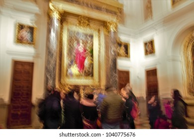 ghostly figures in the cathedral, looking at a picture,Impressionist photo at very low speed of blurred human figures in movement, camera trepidation on purpose to give a sense of unreality, mystery