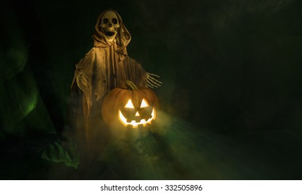A ghostly ghoul guarding a smiling Halloween pumpkin