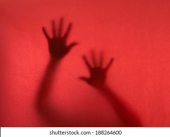 Ghostly hands reach to the camera. Desperation, oppression, cry for help concept. fear, phobia.