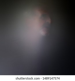 Ghostly image of male gray hair mustache goatee behind veil or screen, expressing anguish fear depression mental health psychological suffering grieving tortured soul copy space square format photo