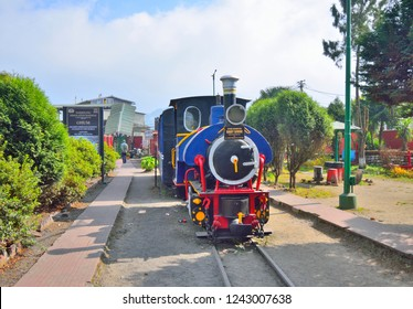 Ghum, India - November 17, 2018: A toy train on display at the railway station.