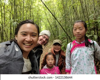 Giang Ta Chai, Lao Cai Province / Vietnam - Jan 20, 2019: tourists taking a selfie with local Hmong guides in Sapa