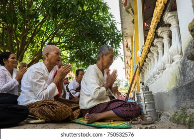 An Giang, Vietnam - Dec 6, 2016: Champa Buddhists praying in temple at ordination ceremony that change the Vietnamese young men to be adult in Chau Doc district