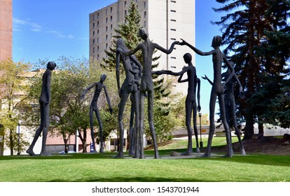 Giant aluminium figures known as the Brotherhood of Mankind, sculptures displayed in the public park in downtown Calgary. Calgary, Canada. October 2019