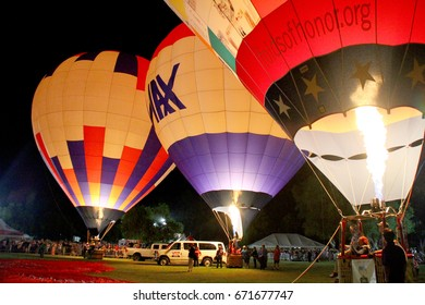 "Giant ballons are inflated during the ""Night Glow"" event on day 1 of the 2017 Temecula Valley Wine and Balloon Festival on June 2, 2017 at the Lake Skinner Recreation Area in Temecula, CA."