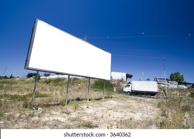 Giant billboard near a public road with cars passing by