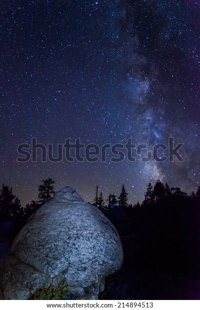 Giant boulder in front of Milky Way at Glacier Point in Yosemite National Park