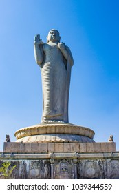 Giant Buddha Statue against the Blue Sky in the Middle of Hussain Sagar Lake in Hyderabad, India