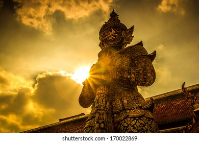 Giant Buddha in Wat Phra Kaeo, Temple of the Emerald Buddha and the home of the Thai King. Wat Phra Kaeo is one of Bangkok's most famous tourist sites and it was built in 1782 at Bangkok, Thailand.