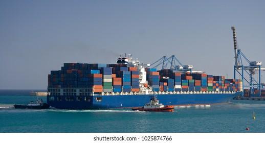 A giant container ship in the harbor of Birzebbuga, Malta.