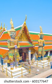 The Giant Demon Guardian with Temple and Blue Sky Background at Wat Phra Kaew, Grand Palace, Bangkok, Thailand.