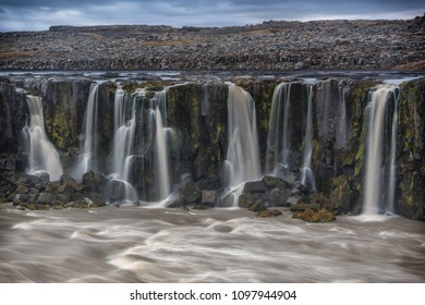 Giant Dettifoss waterfall in Vatnajokull N.P. in northeast Iceland. River after the waterfall. The most powerful waterfall in Europe.