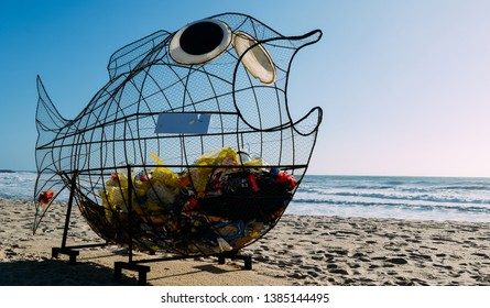 Giant fish shaped trash bin on a beach in Espinho, Portugal.