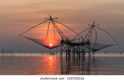 Giant fishing gear call Yor in Thai with beautiful sunrise scenery at Pakpra canal, Phatthalung.
