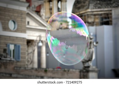 Giant flying soap bubble in city