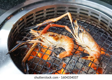 giant freshwater prawn grilled on charcoal stove