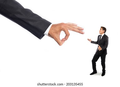 Giant hand flick a scared businessman
