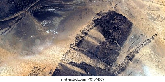 giant insect, fossilized lobster, abstract photography of the deserts of Africa from the air, bird's eye view, abstract expressionism, contemporary art, Science fiction, optical illusions,