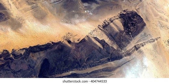 giant insect,allegory, tribute to Pollock, abstract photography of the deserts of Africa from the air,aerial view, abstract expressionism, contemporary photographic art, abstract naturalism,