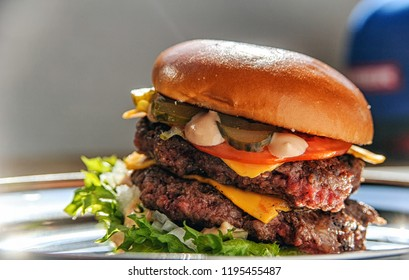 Giant juicy double burger with various toppings