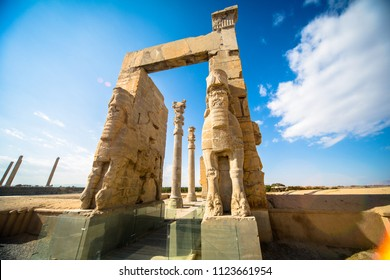 Giant lamassu statues guarding Gate of All Nations, against blue sky in ancient Persepolis, capital of Achaemenid Empire in Shiraz, Iran.