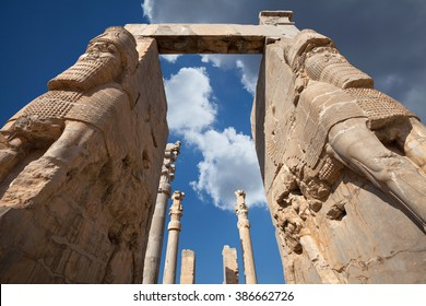 Giant lamassu statues guarding Gate of All Nations, against blue sky with dramatic bright white clouds in ancient Persepolis, capital of Achaemenid Empire in Shiraz, Iran.