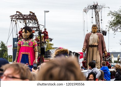 Giant little girl leads the giant man into Liverpool for their finale.  Seen on Sunday 7th October 2018 in Liverpool during Liverpool's Dream - the final saga of the Giants by Royal De Luxe.