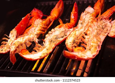 Giant lobster grilling on flame
