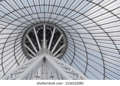 Giant metall colums holding a top of giant conic roof construction. Frame of unusual roof construction.