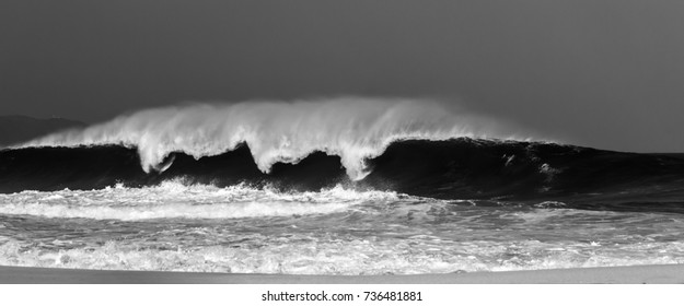 Giant Ocean wave breaking at famous Banzai Pipeline on the north shore of Oahu Hawaii