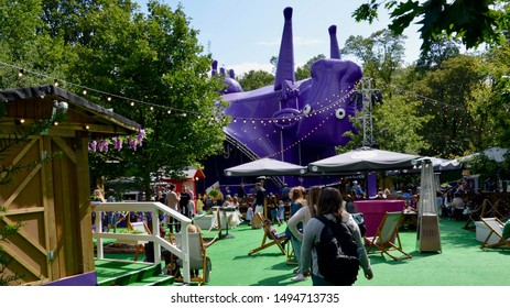 Giant purple inflatable tent part of the Underbelly venues for the Edinburgh Fringe at George Square Gardens, part of Edinburgh University. Scotland August 2019