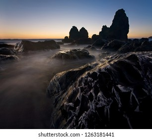 Giant sea stacks and rocky coastline at sunset, at Rodeo Beach, Marin Headlands, California