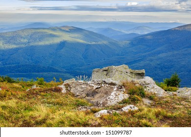 Giant sharp stone on the edge of a cliff in mountains