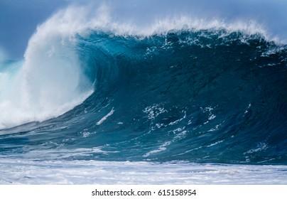 Giant shore break Ocean wave breaking on the beach on the north shore of Oahu Hawaii