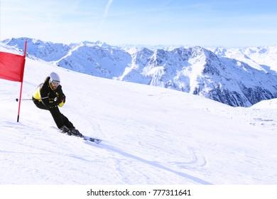 Giant Slalom ski racer skiing downhill in high mountains, Solden, Austria