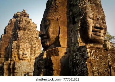 Giant smiling faces carved into the stonework at the Bayon Temple in the Angkor Thom complex, Cambodia.